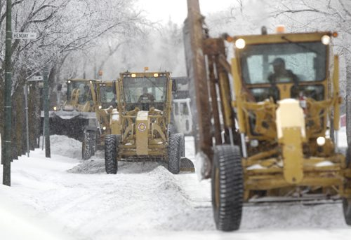 On Thursday, graders scrape Westwood Drive a designated a snow route.  Wayne Glowacki / Winnipeg Free Press Nov. 26. 2013