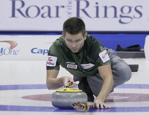 December 3, 2013 - 131203  - Skip Mike McEwen throws during draw 8 against John Epping at the Roar Of The Rings in Winnipeg Tuesday, December 3, 2013. John Woods / Winnipeg Free Press