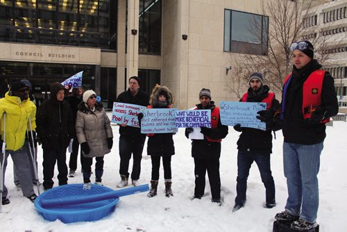 Canstar Community News Justin Collicutt (right, on crate), University of Winnipeg student and rally organizer, voices his concerns about the closure of Sherbrook Pool during a rally outside City Hall on Wednesday. The pool was closed one year ago, and Colicutt says it's putting kids out of swimming lessons. A milk crate acted as a soapbox for attendees to stand up on and voice their opinions on the pool's closure. (JORDAN THOMPSON)