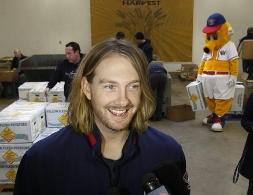 Winnipeg Goldeyes pitcher Brendan Lafferty speaks to the media while volunteering with Goldeye staff at Winnipeg Harvest Tuesday morning . The signing was announced of the left-handed pitcher Brendan Lafferty to a contract for the 2014 season. Melissa Martin story Wayne Glowacki / Winnipeg Free Press Dec.17. 2013