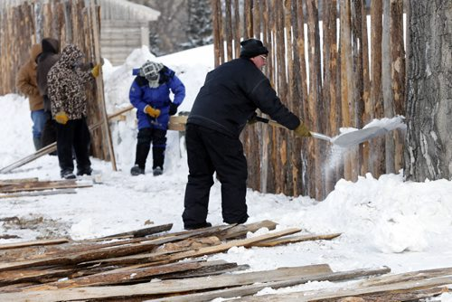 STDUP - Voyageur weather at -30 – hardy voyageurs like Rob Cable  shoveling snow  began the first  site preparation for the up coming winter festival . A work crew was busy putting up fence  s along entrance to Festival park  JAN. 6 2014 / KEN GIGLIOTTI / WINNIPEG FREE PRESS