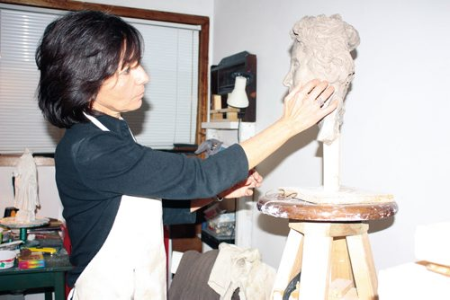 Canstar Community News Jan. 2/13 - North Kildonan artist Débora Cardaci is shown working on a sculpture in her studio. (DAN FALLOON/CANSTAR COMMUNITY NEWS/HERALD)