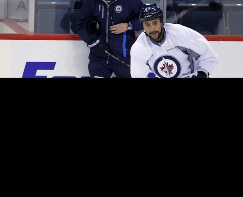 Winnipeg Jets Practice - Dustin Byfuglien. BORIS MINKEVICH / WINNIPEG FREE PRESS January 10, 2014