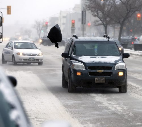 Stdup - This is garbage , a garbage bag swirls above traffic in high winds on Portage  Ave -Stdup – Weather -Winnipeg is  feeling the - 17 with high winds and blowing snow  JAN. 15 2014 / KEN GIGLIOTTI / WINNIPEG FREE PRESS
