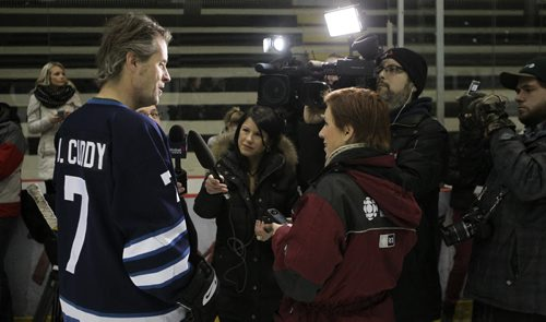 Jim Cuddy, Blue Rodeo frontman and captian of the Juno Cup team The Rockers, talks to the media during the Juno Cup Training Camp at the MTS Iceplex Thursday morning. Former NHL greats and some Canadian music legends took to the ice at the MTS Iceplex for the Juno Cup Training Camp Thursday morning. The Juno Cup is a celebrity charity hockey game that takes place prior to the Juno Awards and pits former NHL stars and some of Canada's fearless musicians. 140123 - Thursday, January 23, 2014 -  (MIKE DEAL / WINNIPEG FREE PRESS)