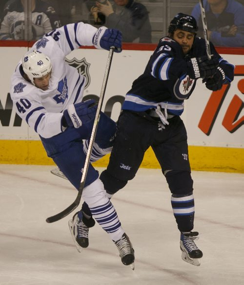 Jets' forward Dustin Byfuglien knocks down Leafs' forward Troy Bodie in the second period at MTS Centre Saturday night.  140125 - Saturday, {month name} 25, 2014 - (Melissa Tait / Winnipeg Free Press)