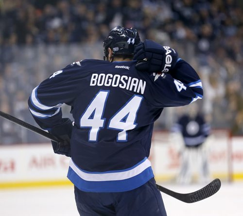Winnipeg Jets' Zach Bogosian (44) celebrates by taking the monkey off his back after he scored against the Toronto Maple Leafs' during second period NHL hockey action at MTS Centre in Winnipeg, Saturday, January 25, 2014. (TREVOR HAGAN/WINNIPEG FREE PRESS)