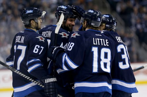 Winnipeg Jets' Michael Frolik (67), Andrew Ladd (16), not shown, Zach Bogosian (44), Bryan Little (18) and Tobias Enstrom (39) celebrate after Bogosian scored against the Toronto Maple Leafs' during second period NHL hockey action at MTS Centre in Winnipeg, Saturday, January 25, 2014. (TREVOR HAGAN/WINNIPEG FREE PRESS)