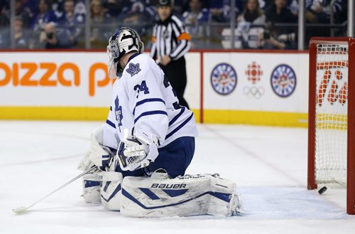 A shot by Winnipeg Jets' Zach Bogosian (44) gets past Toronto Maple Leafs' goaltender James Reimer (34) during second period NHL hockey action at MTS Centre in Winnipeg, Saturday, January 25, 2014. (TREVOR HAGAN/WINNIPEG FREE PRESS)