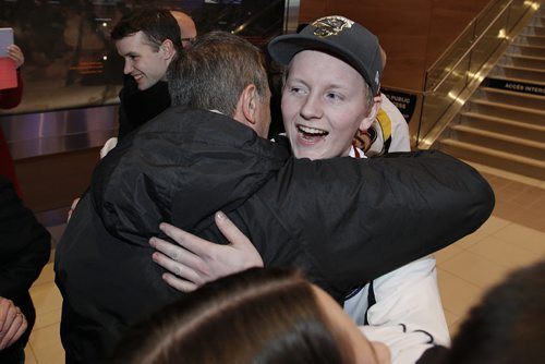 January 27, 2014 - 140127  - Canadian junior curling champion Braden Calvert is greeted by a supporter as the team arrives at the Winnipeg airport Monday, January 27, 2014. John Woods / Winnipeg Free Press
