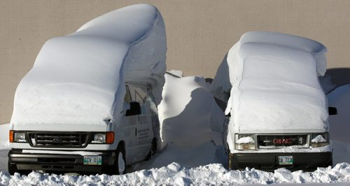 Snow Brush Required- Service trucks covered in massive snow drifts at the Sears at 1725 Inkster Blvd  – Standup photo- Jan 28, 2014   (JOE BRYKSA / WINNIPEG FREE PRESS). weather