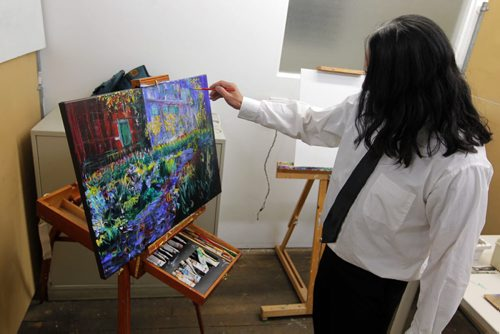 A 24-hour Art-a-thon kicked off is at 1 p.m. today at Artbeat Studio, 62 Albert Street. This evening Hai Romana is one of the artists participating. BORIS MINKEVICH / WINNIPEG FREE PRESS. FEB 6, 2014