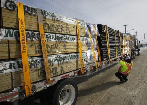 Trucker Kelly Ring checks his rig in Winnipeg Wednesday before hauling building supplies to the Garden Hill First Nation. For Alex Paul story on Winter Roads.  Wayne Glowacki / Winnipeg Free Press Feb. 19   2014