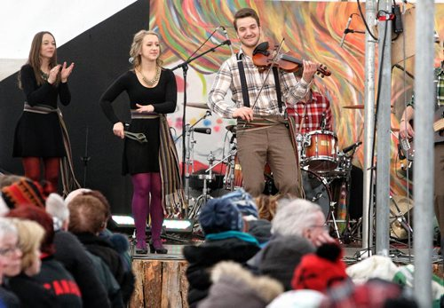 Despite the biting wind hundreds took in the entertainment on the last day of the Festival du Voyageur Sunday. Members of ¾áa Claque! perform, Nicolas Messener on the fiddle and St¾©phanie Touchette on the spoons. 140223 - February 23, 2014 MIKE DEAL / WINNIPEG FREE PRESS