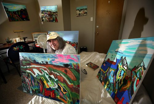 "Wayne Bryant poses in his room with his paintings. He's a resident of ""The Madison"" a rooming house turned shelter now run by Siloam Mission for recovering homeless addicts. See Randy Turner's Homeless feature. February 20, 2014 - (Phil Hossack / Winnipeg Free Press)"