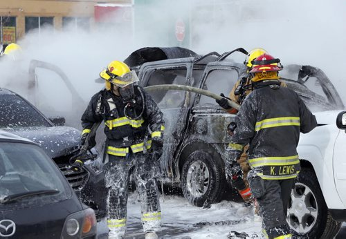 Car explosion  and fire in parking lot of Super Store on Sargent Ave at St. James St , there was one large explosion that rocked the store  then one or two smaller ones , the van that exploded was carrying propane  , 3 other cars were damaged ,   , roof ripped off van . Mar. 3 2014 / KEN GIGLIOTTI / WINNIPEG FREE PRESS