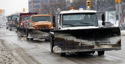 Stdup , Portage Ave ,Snow Ploughs out in force  to deal with new a snow fall  as well as remnants of several past ones . Mar. 6 2014 / KEN GIGLIOTTI / WINNIPEG FREE PRESS