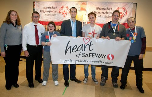 Special Olympics - Canada Safeway Madison Avenue Store  Safeway kicked off their annual Special Olympics fundraising efforts with a bocce bowling event at their Madison Avenue Location. Local celebrities teamed up with Special Olympians for the in-store competition. Donations can be made at all Safeway locations. Visit specialolympics.mb.ca to learn more about Special Olympics in Manitoba.  (L-R)) Phyllis Fehr (Madison Square Safeway Assistant Manager) and Rick Champagne (Store Manager), Darcie Godard (Special Olympics Manitoba athlete), Mitch Rosset (Global Winnipeg), Matt Sutton (Fresh 99.1 FM Radio), Derek Taylor (Global Winnipeg), Doug Slobodian (Special Olympics Manitoba athlete)