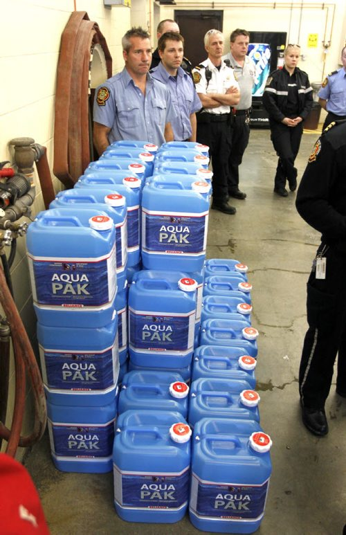 Update on City services relating to frozen water pipes. Winnipeg Fire Paramedic Service preparing water jugs for delivery at Winnipeg Fire and Paramedic Station 22, 1567 Waverley Street.  Here are some of the jugs that will be used. BORIS MINKEVICH / WINNIPEG FREE PRESS  March 7, 2014