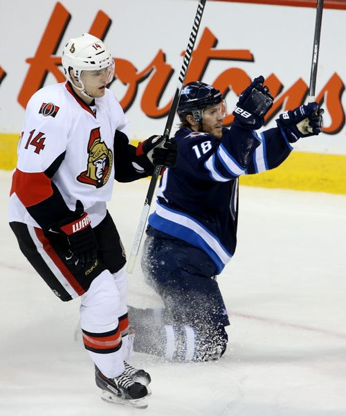 Ottawa Senators' Colin Greening (14) skates past a celebrating Winnipeg Jets' Bryan Little (18) after he put the puck past Ottawa Senators' goaltender Craig Anderson (41) during first period NHL hockey action at MTS Centre in Winnipeg, Saturday, March 8, 2014. (TREVOR HAGAN/WINNIPEG FREE PRESS)