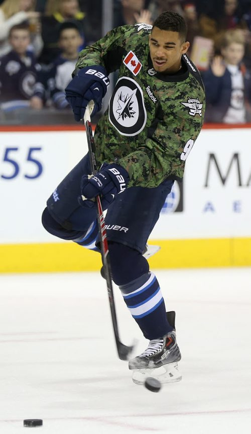 Winnipeg Jets' Evander Kane (9)  fires a shot during warmup while wearing a camouflage jersey on Military Appreciation day prior to the game against the Ottawa Senators', Saturday, March 8, 2014. (TREVOR HAGAN/WINNIPEG FREE PRESS)