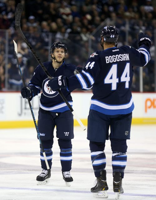 Winnipeg Jets' Tobias Enstrom (39) celebrates his goal with Zach Bogosian (44) against the Ottawa Senators' during second period NHL hockey action at MTS Centre in Winnipeg, Saturday, March 8, 2014. (TREVOR HAGAN/WINNIPEG FREE PRESS)