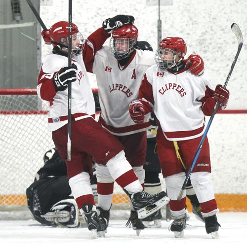 After scoring late in the game, Kelvin Clippers player Stephen McGregor in centre  celebrates his goal with team mates Noah Mendoza ( right ) and Riley Gilmore during their AAAA Provincial Tournament semi-final game at the Gateway Recreation Centre Friday against the Dauphin Clippers . The Kelvin Clippers  defeated the Dauphin Clippers 6-1.   Wayne Glowacki / Winnipeg Free Press March 14   2014