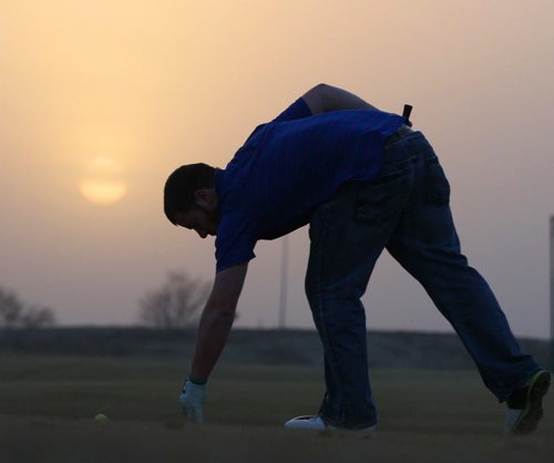 Spring Found- Sioux Falls, South Dakota- Michael Thompson,  enjoys 15C weather at the Prairie Green Golf Course Wednesday evening in a t-shirt at the driving range-    See Randy Turner find spring story- March 26, 2014   (JOE BRYKSA / WINNIPEG FREE PRESS)