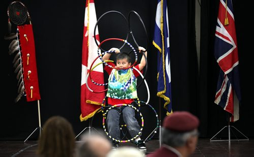 Six year old kindergarden student Phoenix Desjarlais  struts his stuff Friday afternoon at the 18th ANNUAL Winnipeg Police Service NORTH END SPRING FEAST. The six year old also is one of William Whyte's star square dancers. See release April 11, 2014 - (Phil Hossack / Winnipeg Free Press)