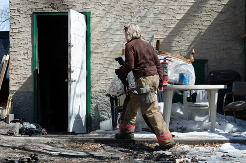 A fire official enters a home on the 300 block of Enfield Crescent near Marion Street to investigate the cause of an early morning fire.  The basement resident died as a result of the fire.  EMILY CUMMING / WINNIPEG FREE PRESS APRIL 16, 2014