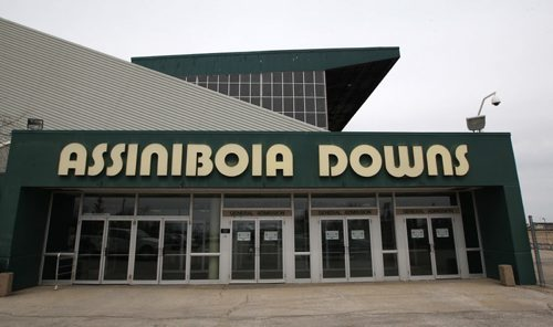 Assiniboia Downs CEO Darren Dunn, not pictured, announced today The government of Manitoba and the Manitoba Jockey Club have reached a comprehensive agreement that resolves all matters outstanding between them regarding the continuation of live horse racing at Assiniboia Downs. –  Here a better watches simulcast horse racing at the Race Book at the Downs-See  Paul Wiecek story- Apr 23, 2014   (JOE BRYKSA / WINNIPEG FREE PRESS)