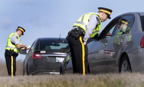 On Thursday morning, RCMP East Traffic Services held a Checkstop on the off-ramps from Roblin Bvld. to the Perimeter Hwy. to kick off their increased enforcement for this May long weekend.  The RCMP wants to remind drivers to follow the basic rules, drive sober, slow down, buckle up and leave that cell phone alone. See RCMP news release.  Wayne Glowacki / Winnipeg Free Press May 15 2014