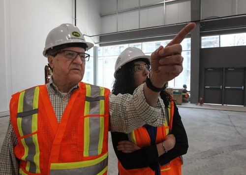 Dr. Lloyd Axworthy and project manager Linda Palmer on a tour of the University of Winnipeg RecPlex which is still under construction. 140522 - Thursday, May 22, 2014 -  (MIKE DEAL / WINNIPEG FREE PRESS)
