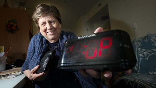 """Viola Dufresne shows off her """"Granny Cam"""" hidden in a digital clock. The 82 year old used the device to catch care worker red handed on video. See Mike MacIntyre's story. May 23, 2014 - (Phil Hossack / Winnipeg Free Press)"""