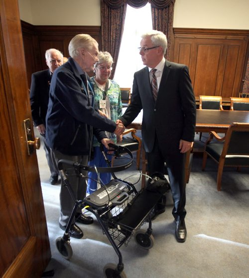 Bill McGowan speaks with Premier Greg Selinger Monday afternoon at the Legislature. Two other veterans of the Battle Normandy will accompany Selinger to Europe for the anniversary June 4. Invited, McGowan is unable to go. See Bruce Owen story. May 26, 2015 - (Phil Hossack / Winnipeg Free Press)