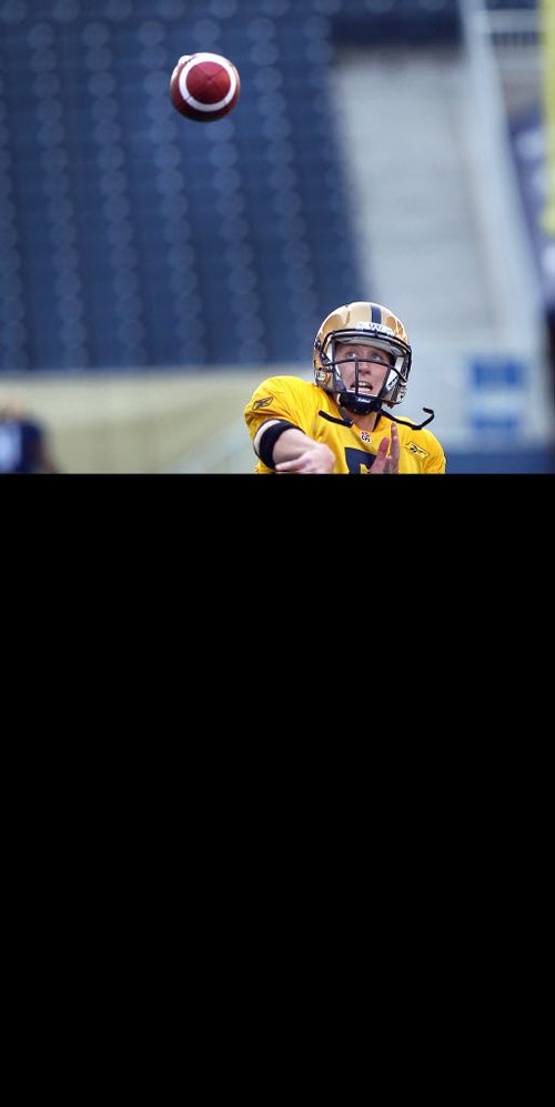 Quarterback Drew Willy at practice Wednesday evening. See Ed Tait's tale. May 28, 2014 - (Phil Hossack / Winnipeg Free Press)