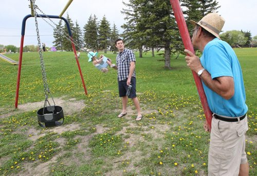 Crestview residents are upset with Coun. Grant Nordman's plans to convert Voyageur Park into an off-leash dog park. Dan Legg with his daughter Audrey  chat with neighbor John Bazarkewich, right , about new plans for park Thursday.Aldo Santin story- May 21, 2014   (JOE BRYKSA / WINNIPEG FREE PRESS)