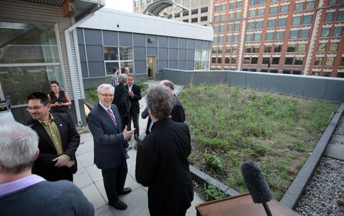 Premier Greg Selinger chats with guests after a brief awards ceremony on the rooftop of MEC Friday Morning. See release? May 30, 2014 - (Phil Hossack / Winnipeg Free Press)