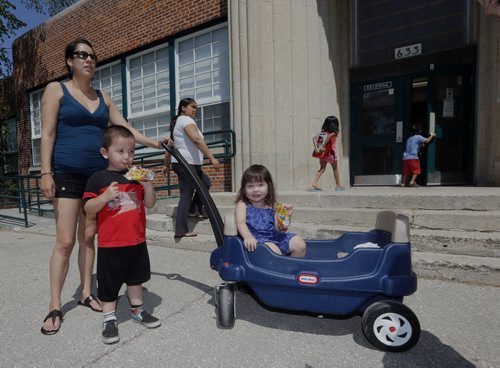 left Cheyenne Tizya  with her kids Ethan age 3 and Jaylynn age 2 outside  Inkster School .Inkster School parents favour reduction of speed but would like to see Inkster Blvd reduced also . REDUCED SPEED ZONES — A report that proposes a new bylaw to establish reduced-speed school zones in Winnipeg will be considered Tuesday by the Committee on Infrastructure Renewal and Public Works. If approved by the city, maximum speed limits of 30 km/h would be set up around 171 Winnipeg schools, in effect from 7 a.m. to 5:30 p.m., Monday to Friday during the months of September to June. Story Santin Rollason  May 30 2014 / KEN GIGLIOTTI / WINNIPEG FREE PRESS