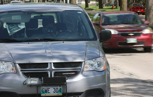 A mobile photo radar unit on Burrows Ave in school zone Tuesday-Operator uses handheld device to capture traffic coming from other direction- His vehicle can capture tickets from both directions- See Aldo Santin story- June 03, 2014   (JOE BRYKSA / WINNIPEG FREE PRESS)