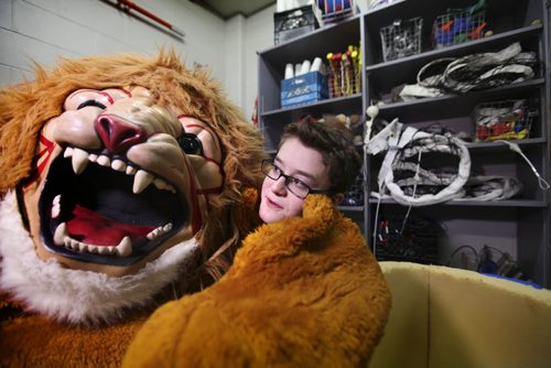 Noah puts on the schools mascot, a lion costume stored in the school gymnasium's equipment room at Glen Lawn Collegiate.  His role as the class clown at Windsor School seems to fit him well at his new school.  Former Windsor School students face new challenges and take on new responsibilities in their first year in grade nine at Glen Lawn Collegiate. See Doug Speirs story.  June 04, 2014 Ruth Bonneville / Winnipeg Free Press