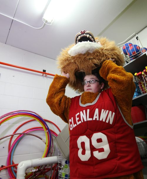 Noah puts on the schools mascot, a lion costume stored in the school gymnasium's equipment room at Glen Lawn Collegiate.  His role as the class clown at Windsor School seems to fit him well at his new school.  Former Windsor School students face new challenges and take on new responsibilities in their first year in grade nine at Glenlawn Collegiate. See Doug Speirs story.  June 04, 2014 Ruth Bonneville / Winnipeg Free Press