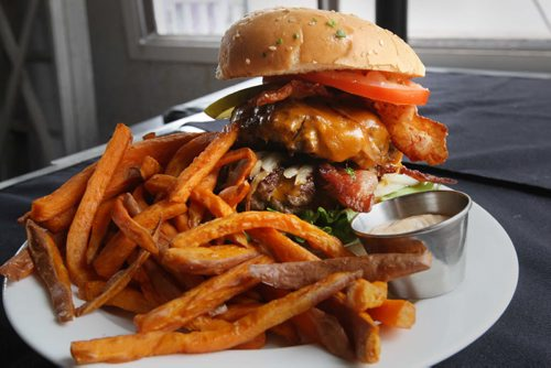 Cravings-266 4th Street East, Stonewall, MB, Canada-Double Deluxe burger with sweet potato fries- See Marion Warhaft review- June 17, 2014   (JOE BRYKSA / WINNIPEG FREE PRESS)