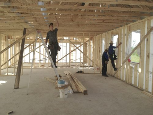 Inside school: Chad Bauman of the Pine Creek Mennonite Church helps members of the Old Order Mennonite community with construction inside the new school. The teen is one of dozens of Mennonites from across the province and beyond who travelled to the Old Order Mennonite community to help. (Ian Hitchen/ Brandon Sun )