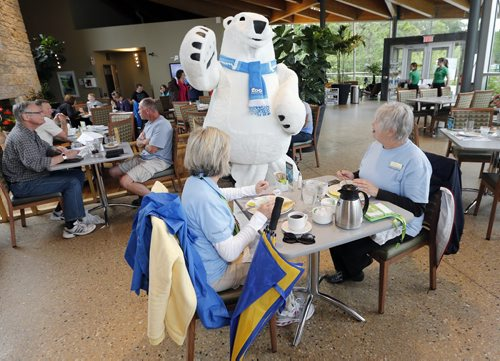 Stdup Ploar Bear Sighting - Zoo Mascot unveiled to the public . The Assiniboine Park Conservancy  , Journey to Churchill 's new mascot Winston made his first public appearance  meeting LtoR Donna Remillard  and Ruth Boyd  having lunch at the Qualico Family Centre just before noon Monday. The JtoC  is set to open Thurday  June 30 2014 / KEN GIGLIOTTI / WINNIPEG FREE PRESS