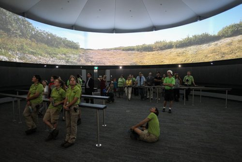 Visitors watch a film in the Aurora Borealis Theatre in the Journey to Churchill exhibit. The grand opening of the Assiniboine Park Zoo exhibit Journey to Churchill was a new experience for many Winnipeggers as well as the polar bears who were introduced to their new home only hours earlier. 140703 - Thursday, July 03, 2014 -  (MIKE DEAL / WINNIPEG FREE PRESS)