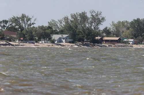 Water laps the shore along Twin Lakes Beach Sunday morning, a couple weeks from now the water conditions could be worse than the flood of 2011. 140706 - Sunday, July 06, 2014 -  (MIKE DEAL / WINNIPEG FREE PRESS)