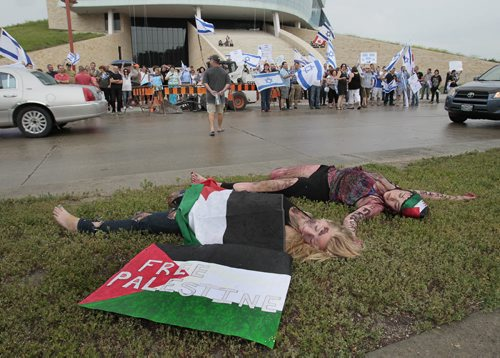 """July 21, 2014 - 140721  -  Palestinian supporters take part in a """"die-in"""" as about 100 Israel supporters gather for a rally in downtown Winnipeg Monday, July 21, 2014. John Woods / Winnipeg Free Press"""