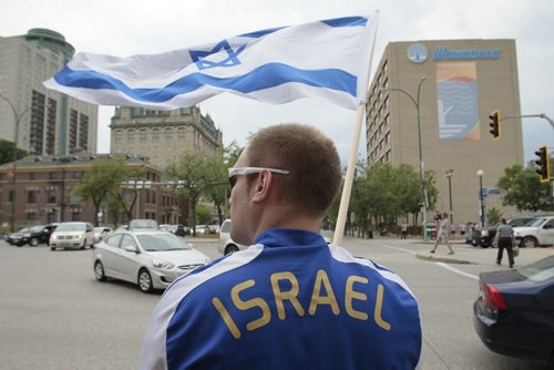 July 21, 2014 - 140721  -  About 100 Israel supporters gather for a rally on Main Street Winnipeg Monday, July 21, 2014. John Woods / Winnipeg Free Press