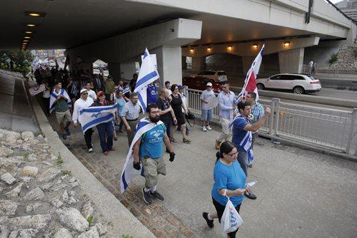 July 21, 2014 - 140721  -  About 100 Israel supporters gather for a rally on Main Street Winnipeg Monday, July 21, 2014. John Woods / Winnipeg Free Press